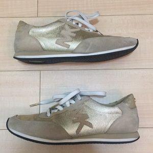 Michael Kors gold sneakers.
